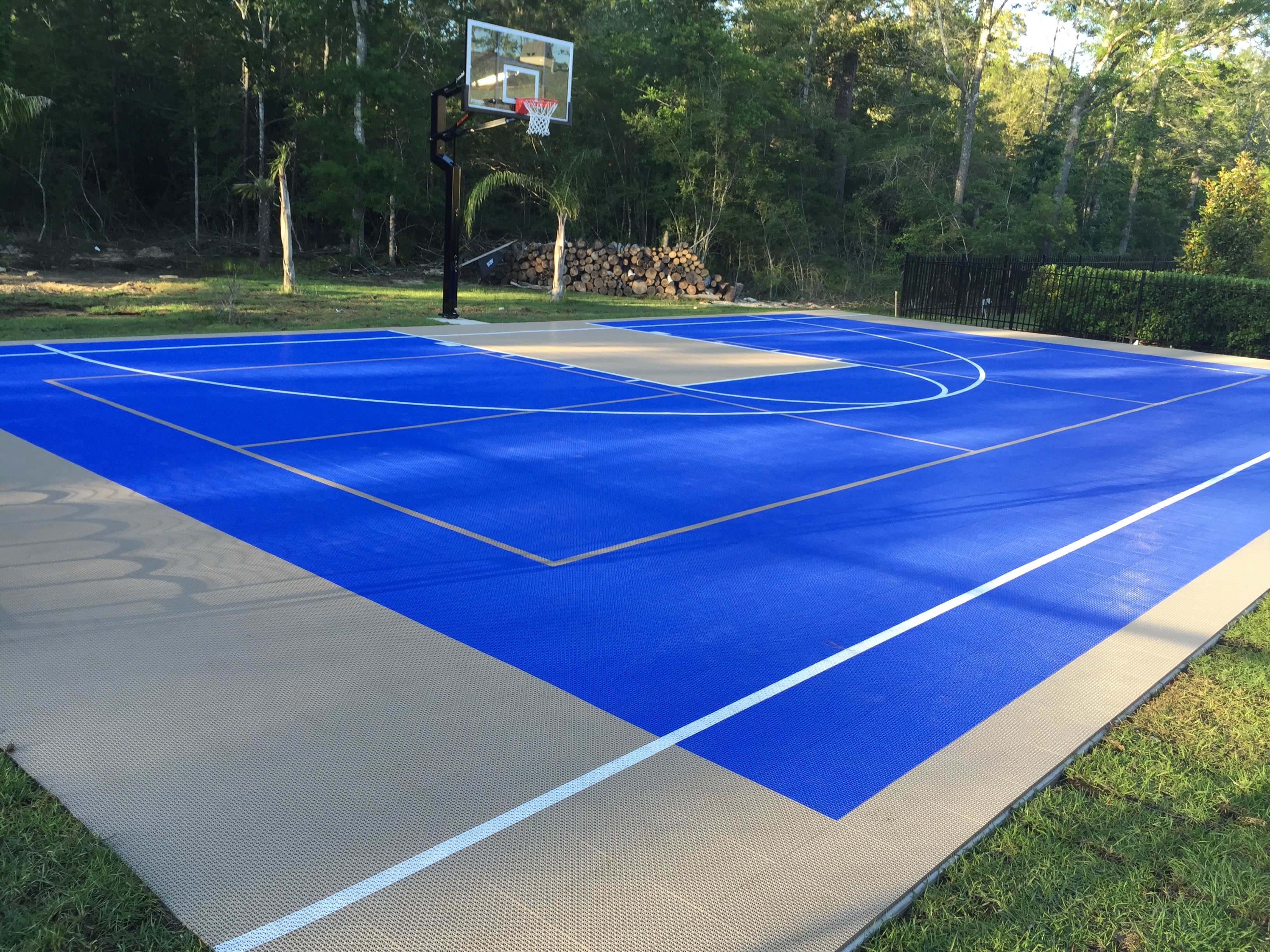 64' x 40' basketball, pickle ball, volleyball court in bright blue and beige